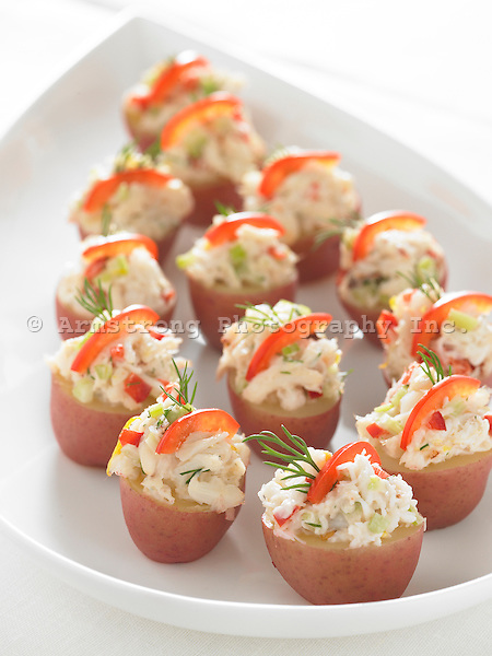 Appetizer tray—small red potatoes with dungeness crab, red pepper, dill