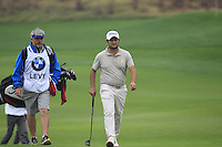 Alexnader Levy (FRA) and caddy Bo on the 9th green during Thursday's Round 1 of the 2014 BMW Masters held at Lake Malaren, Shanghai, China 30th October 2014.<br /> Picture: Eoin Clarke www.golffile.ie