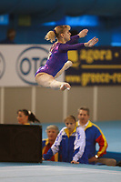 Alina Kozich of Ukraine  straddle jumps on floor exercise to help Romania win silver in women's senior team competition at 2006 European Championships Artistic Gymnastics at Volos, Greece on April 29, 2006.  (Photo by Tom Theobald)
