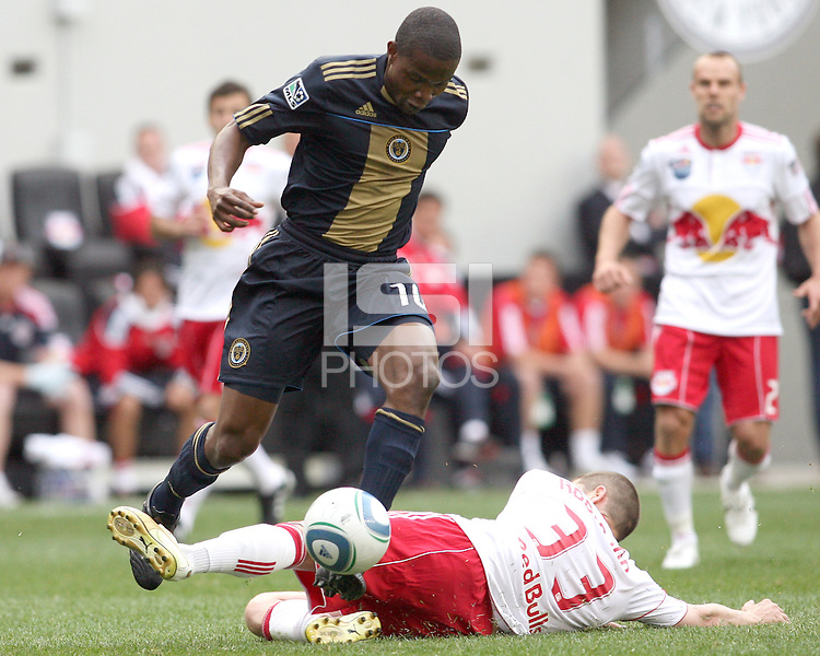 Danny Mwanga #10 of the Philadelphia Union moves the ball over Carl Robinson #33 of the New York RedBulls during a MLS  match on April 24 2010, at RedBull Arena, in Harrison, New Jersey.