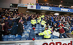 Rangers and Hearts fans indulge in some aggro after referee Bobby Madden calls a halt to the match