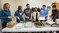 NWA Democrat-Gazette/BEN GOFF @NWABENGOFF<br /> The Talarski family of Rogers, including (from left) Bobbi, Hannah, Caleb, Shania, Isaac and Elijah, fill takout boxes Thursday, Nov. 28, 2019, during the annual Thanksgiving meal distribution at the First Baptist Church Olive Street campus in Rogers. <br /> <br /> Paul Olinger, a church member who helped coordinate the meal, said the event started 20 years ago 'As an outreach of the church to show the love of Christ in the community'. Volunteers from the church and the community cooked, packaged and delivered boxed meals that included ham, green beans, mashed potatoes and deserts. <br /> <br /> Open to anyone, a line wrapped around the room as families picked up boxes of food to take home, but Olinger estimates that 98 percent of the meals are delivered by volunteers.