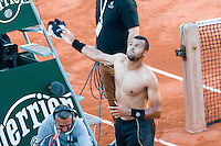 June 2, 2015: Jo-Wilfried Tsonga of France celebrates after winning a Quarterfinal match against Kei Nishikori of Japan on day ten of the 2015 French Open tennis tournament at Roland Garros in Paris, France. Sydney Low/AsteriskImages