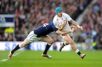 Jack Nowell of England is tackled by Dougie Fife of Scotland