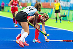 Agustina Habif #14 of Argentina passes while Lily Owsley #26 of Great Britain tries to stop the pass during Argentina vs Great Britain in women's Pool B game  at the Rio 2016 Olympics at the Olympic Hockey Centre in Rio de Janeiro, Brazil.