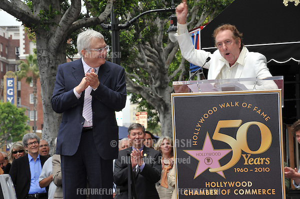 Composer Randy Newman (left) & Eric Idle on Hollywood Boulevard where Newman was honored today with a star on the Hollywood Walk of Fame..June 2, 2010  Los Angeles, CA.Picture: Paul Smith / Featureflash