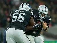 Oakland Raiders Quarterback Derek Carr (4) is sacked