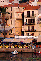 Mediterranean seaport, colorful buildings, outdoor cafes and boats, Corsica Island, France