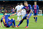 Luis Suarez of FC Barcelona (L) getting up from the help with Paulinho Maciel of FC Barcelona (R) during the La Liga 2017-18 match between FC Barcelona and Deportivo La Coruna at Camp Nou Stadium on 17 December 2017 in Barcelona, Spain. Photo by Vicens Gimenez / Power Sport Images