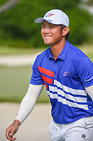 Yung-Hua LIU (TPE) departs the green on 18 following Rd 1 of the Asia-Pacific Amateur Championship, Sentosa Golf Club, Singapore. 10/4/2018.<br /> Picture: Golffile | Ken Murray<br /> <br /> <br /> All photo usage must carry mandatory copyright credit (&copy; Golffile | Ken Murray)