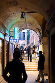 ITALY, Venice. People walking in covered alley by St. Mark's Square.