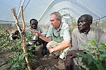 Father Richard O'Dwyer, a Jesuit from Ireland, talks with men in a greenhouse at the Multi Agricultural Jesuit Institute of Sudan (MAJIS), an agricultural school located outside Rumbek, South Sudan. O'Dwyer is the school's director.