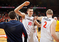 Virginia forward/center Mike Tobey (10) and Virginia guard Paul Jesperson (2) celebrate the 61-58 win over Maryland Sunday in Charlottesville, VA. Photo/Andrew Shurtleff