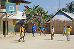 Young Kuna boys play basketball on Rio Sidra, San Blas Islands, Kuna Yala, Panama