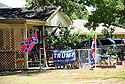 A Confederate Flag and Trump banner fly on a house near Marksville High School,' Marksville, La., Sept. 17, 2017.