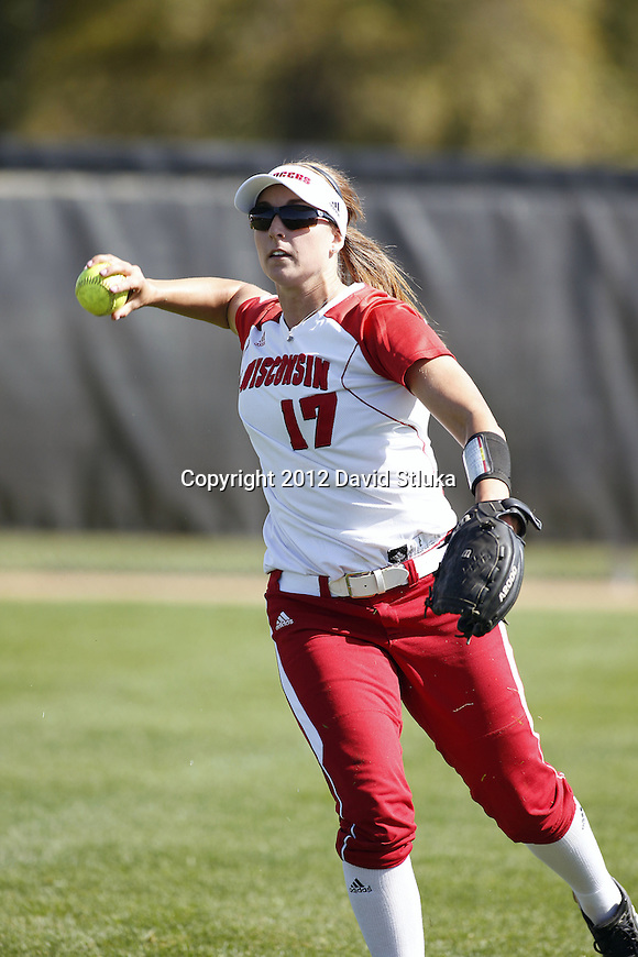 Wisconsin Badgers Kendall Grimm (17) throws the ball during warmups prior to an NCAA women's softball game against the Green Bay Phoenix Saturday, September 29, 2012 in Madison, Wis. (Photo by David Stluka)