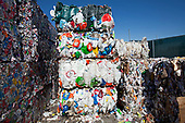Stacks of High-density polyethylene (HDPE) bottles, recycliing symbol #2. Recycling Center, Los Angeles, California, USA