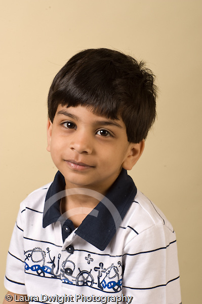 closeup headshot portrait of boy age 4 or 5 vertical