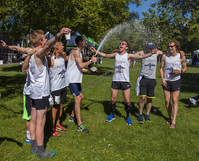 The Prominence Health Plan team celebrates after their record setting run during the 2019 Reno Tahoe Odyssey at Idlewild Park in Reno on Saturday, June 1, 2019.