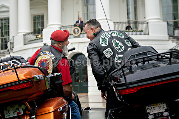 Actor Robbert Patrick, right, talks to an attendee while sitting on motorcycles during a Rolling to Remember ceremony honoring the nation's veterans and prisoners of war/missing in action (POW/MIA) in Washington, D.C., U.S., on Friday, May 22, 2020. United States President Donald J. Trump didn't wear a face mask during most of his tour of Ford Motor Co.'s ventilator facility Thursday, defying the automaker's policies and seeking to portray an image of normalcy even as American coronavirus deaths approach 100,000. <br /> Credit: Andrew Harrer / Pool via CNP/AdMedia