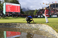 Scott Hend (AUS) at the waters edge on the 18th green on the 3rd playoff hole during Sunday's Final Round of the 2017 Omega European Masters held at Golf Club Crans-Sur-Sierre, Crans Montana, Switzerland. 10th September 2017.<br /> Picture: Eoin Clarke | Golffile<br /> <br /> <br /> All photos usage must carry mandatory copyright credit (&copy; Golffile | Eoin Clarke)