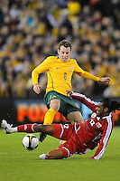 MELBOURNE, AUSTRALIA - OCTOBER 14: Luke Wilkshire from Australia is tackled by Ahmed Mubarak from Oman in a AFC Asian Cup 2011 match between Australia and Oman at Etihad Stadium on October 14, 2009 in Melbourne, Australia. Photo Sydney Low www.syd-low.com