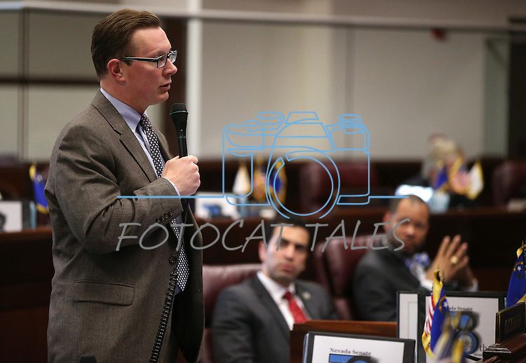 Nevada Sen. Ben Kieckhefer, R-Reno, speaks on the Senate floor at the Legislative Building in Carson City, Nev., on Tuesday, April 7, 2015. <br /> Photo by Cathleen Allison