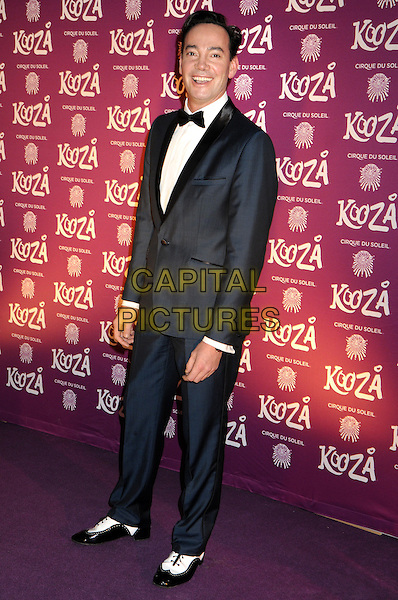 "Craig Revel Horwood.VIP Night for Cirque du Soleil's new production, ""Kooza"" at the Royal Albert Hall, London, England..January 8th 2013.full length black tuxedo bow tie white shirt .CAP/PP/BK.©Bob Kent/PP/Capital Pictures"