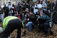 November 23, 2011, Toronto Police and work staff arrived in significant numbers this morning, beginning the process of evicting the Occupy Toronto tent camp from St. James Park.  Here media and protest crowds in large numbers watch as city workers dismantle and remove tents.