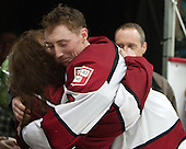 Danny Fick (Harvard - 7) and mom - The Harvard University Crimson honored their seniors following their final home game of the regular season on Saturday, February 22, 2014 at the Bright-Landry Hockey Center in Cambridge, Massachusetts.