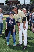 Patrick Frick (5) of the Wake Forest Demon Deacons poses for a photo with a member of the Winston-Salem Miracle League prior to the game against the Pittsburgh Panthers at David F. Couch Ballpark on May 20, 2017 in Winston-Salem, North Carolina. The Demon Deacons defeated the Panthers 14-4.  (Brian Westerholt/Four Seam Images)