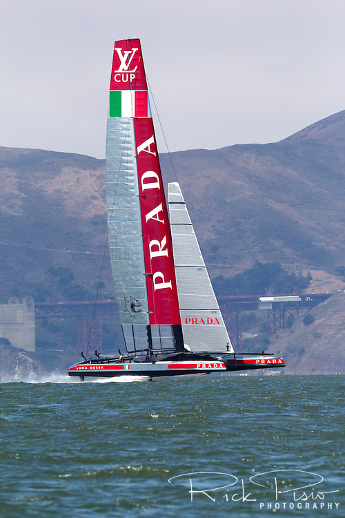 The Luna Rossa Challenge catamaran representing the Circolo della Vela Sicilia in Italy sails on San Francisco Bay during the 2013 Americas Cup competition.
