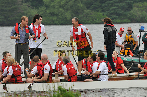 The Duke and Duchess of Cambridge.Royal Tour of Canada. Prince Edward Island, Canada 4th July 2011.canoe life vest.CAP/CAS.©Bob Cass/Capital Pictures.