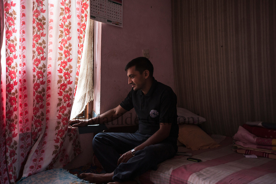 "Nepal - Kathmandu - Dinesh Kumar Bastola, 35, in his house at Pepsi-Cola neighbourhood in Kathmandu. After having worked in Dubai and Malaysia for a total of three years and four months, at the start of 2014 Bastola moved to Qatar, where he was promised to work as an electrician helper. After two months and 19 days without receiving any payment, he complained with the Qatari company he was employed in. Bastola was immediately fired and managed to get only his return ticket to Kathmandu paid. He never received the money due to him. Now he works as a plastic bags salesman, trying to repay the 1,000-USD-loan he has taken to go to Qatar. ""I would prefer to remain in Nepal, but if I will have to go back abroad to work, I hope it will be with a good company this time"" he says."