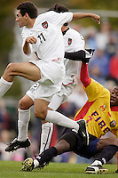 Pablo Brenes of the MetroStars sails through the air past teammate Sergio Galvan Rey, and the Fire's Alexandre Boucicaut as he follows through on his shot that would be the game winning goal. The MetroStars defeated the Chicago Fire 2-0 during the inaugural Hall of Fame game on Monday October 11, 2004 at At-A-Glance Field at the National Soccer Hall of Fame and Museum, Oneonta, NY..
