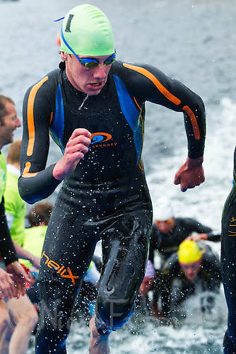 22 MAY 2011 - DUNKERQUE, FRA - Alistair Brownlee (EC Sartrouville) races from the water at the end of the swim during the men's round of the 2011 French Grand Prix triathlon  series .(PHOTO (C) NIGEL FARROW)