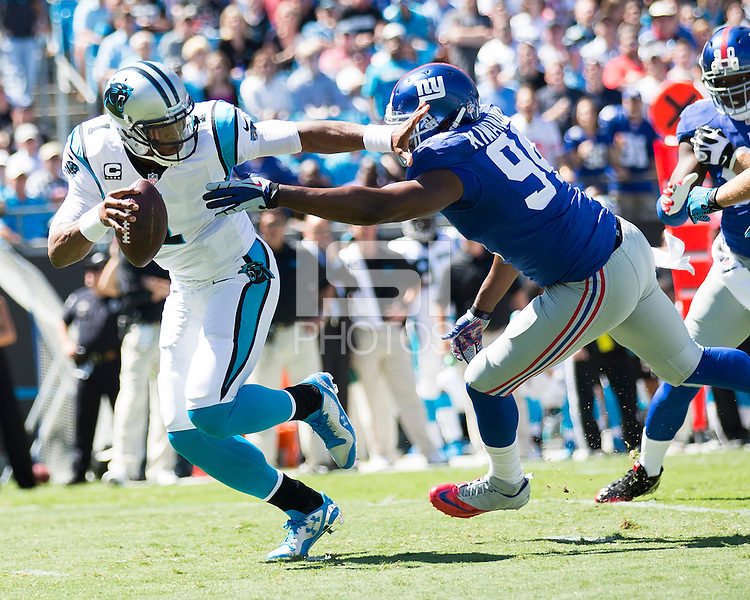 The Carolina Panthers played the New York Giants at Bank of America Stadium in Charlotte, NC.  The Panthers won 38-0 for their first victory of the season.  The Giants dropped to 0-3.  New York Giants defensive end Mathias Kiwanuka (94), Carolina Panthers quarterback Cam Newton (1)