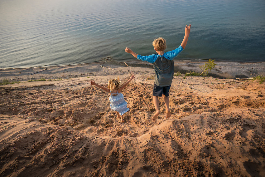 Children play on the sand dunes at Grand Sable Dunes of Pictured Rocks National Lakeshore near Grand Marais, Michigan.