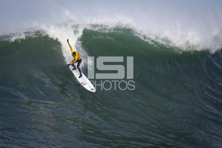 Half Moon Bay, California - January 24, 2014: 2014 Maverick's Invitational Greg Long at the top.