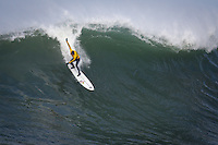 Half Moon Bay, California - January 24, 2014: 2014 Maverick's Invitational Greg Long at the top.