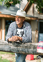 Joe Gallegos on his land near The People's Ditch in San Luis, Colorado, Monday, August 17, 2015. The People's Ditch is the oldest continually used ditch in Colorado. Joe's family has used the ditch for five generations. The People's Ditch was initially a shallow hand-dug irrigation channel. Later, oxen pulling a plow widened and extended the ditch. Operating under Water District 24 of Division 3, the People's Ditch holds the first adjudicated water rights in Colorado.<br /> <br /> Photo by Matt Nager