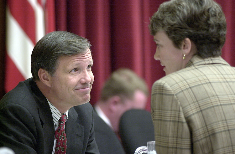 CoxC.3(DG)092100 -- Chris Cox, R-Calif., and Heather Wilson, R-N.M., talk before the start of the hearing on the Firestone Tire recall.