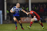 Jack Wilson of Bath Rugby looks to fend Ben Spencer of Saracens. Gallagher Premiership match, between Bath Rugby and Saracens on March 8, 2019 at the Recreation Ground in Bath, England. Photo by: Patrick Khachfe / Onside Images