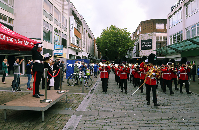 Pictured: H.M. Lord Lieutenant of West Glamorgan<br />D Byron Lewis (L) takes a salute by the Welsh Guards as they parade through Oxford Street in Swansea.  Friday 15 September 2017<br />Re: Soldiers from the Welsh Guards have exercised their freedom to march through the streets of Swansea in Wales, UK.<br />The Welsh warriors paraded with bayonets-fixed from the city centre to the Brangwyn Hall, where the Lord Mayor of Swansea took a salute.