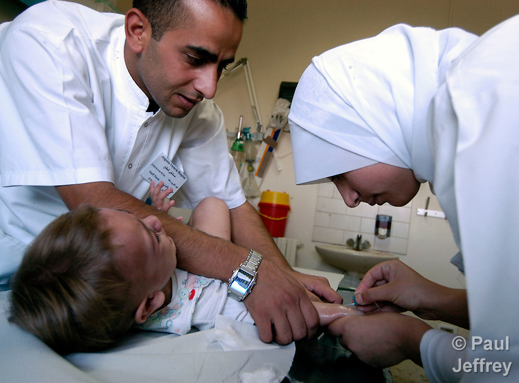 A young patient receives emergency treatment at East Jerusalem's Augusta Victoria Hospital, run by the Lutheran World Federation..