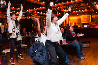 former women's national team player April Heinrichs reacts as it appears the US scores a goal as time expires while watching the USWNT play Germany during the centennial celebration of U. S. Soccer at Nevada Smiths in New York, NY, on April 05, 2013.
