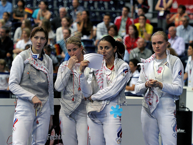 European Championships Fencing 2010 / Fecht Europameisterschaft 2010 in Leipzig - Competition Championat d'europe - im Bild: womens foil team - the Russian national team disappointed after semi finale match against German team - Aida Shanaeva, Inna Deriglazova, Larisa Korobeinikova and Eugyenia Lamonova  . Foto: Norman Rembarz..Norman Rembarz , Autorennummer 41043728 , Augustenstr. 2, 04317 Leipzig, Tel.: 01794887569, Hypovereinsbank: BLZ: 86020086, KN: 357889472, St.Nr.: 231/261/06432 - Jegliche kommerzielle Nutzung ist honorar- und mehrwertsteuerpflichtig! Persönlichkeitsrechte sind zu wahren. Es wird keine Haftung übernommen bei Verletzung von Rechten Dritter. Autoren-Nennung gem. §13 UrhGes. wird verlangt. Weitergabe an Dritte nur nach  vorheriger Absprache..
