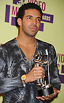 LOS ANGELES, CA - SEPTEMBER 06: Drake poses in the press room during the 2012 MTV Video Music Awards at Staples Center on September 6, 2012 in Los Angeles, California.