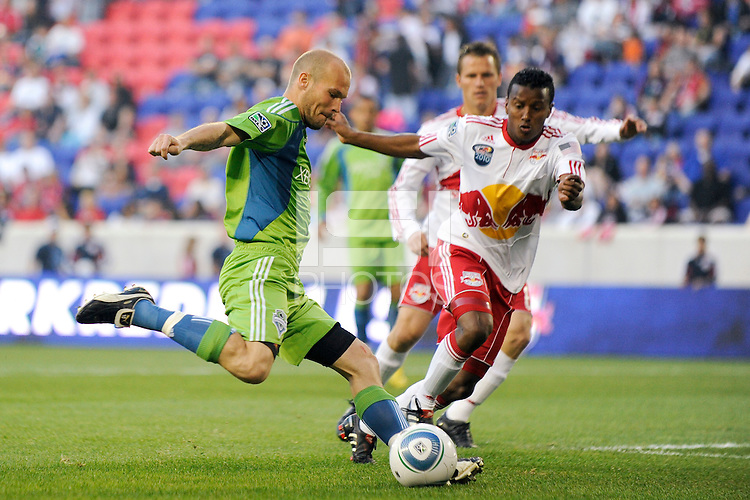 Freddie Ljungberg (10) of the Seattle Sounders takes a shot during a Major League Soccer (MLS) match against the New York Red Bulls at Red Bull Arena in Harrison, NJ, on May 15, 2010.