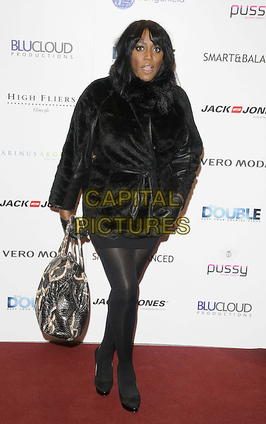 Mica Paris.'The Double' UK film premiere, Jack & Jones, Oxford St., London, England..December 17th 2012.full length black jacket fur coat purse bag hand arm mouth open silver .CAP/CAN.©Can Nguyen/Capital Pictures.